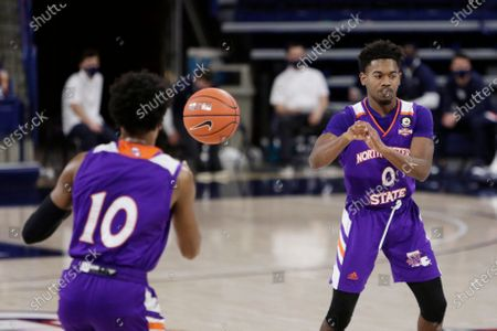 Northwestern State guard CJ Jones (0) passes the ball to guard Jairus Roberson (10) during the second half of an NCAA college basketball game against Gonzaga in Spokane, Wash