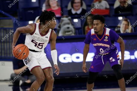 Gonzaga guard Dominick Harris (55) dribbles the ball while pressured by Northwestern State guard CJ Jones (0) during the second half of an NCAA college basketball game in Spokane, Wash