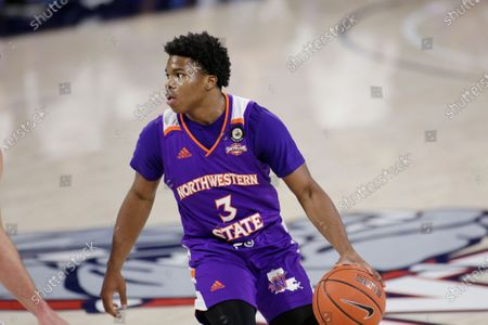 Northwestern State guard Brian White dribbles the ball during the first half of an NCAA college basketball game against Gonzaga in Spokane, Wash