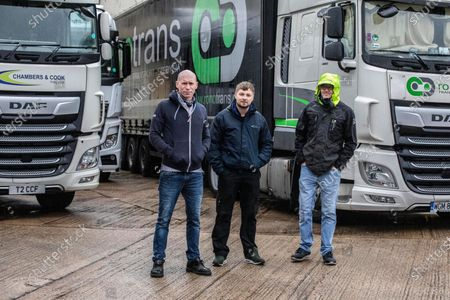British truck drivers (right) Eric Johnson, (middle) Dean Hammond (31) , and (left) Dave King (48) stranded in Dover Port, England, UK