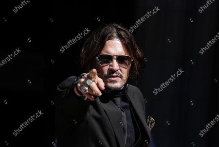 """Actor Johnny Depp arrives at the High Court in London in London, . Actor Johnny Depp is suing News Group Newspapers, publisher of The Sun, and the paper's executive editor, Dan Wootton, over an April 2018 article that called him a """"wife-beater."""" Depp strongly denies all allegations"""