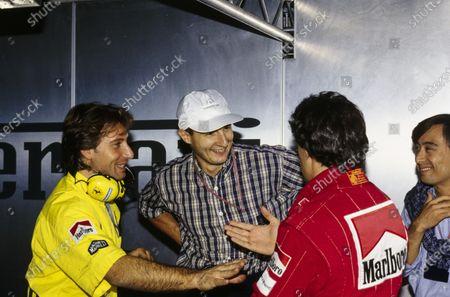 Italian footballer Daniele Massaro chats with Jean Alesi.