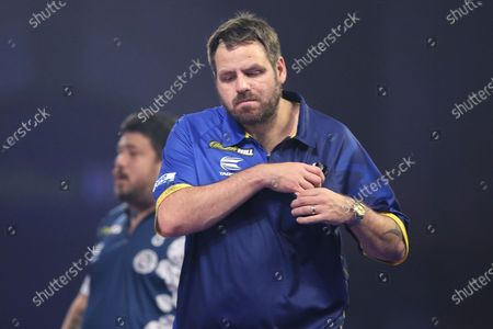 A dejected looking Adrian Lewis during the William Hill World Darts Championship at Alexandra Palace, London