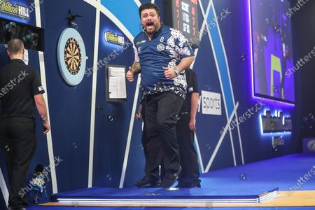 Stock Picture of Danny Baggish hits a double and wins his second round match against Adrian Lewis and celebrates during the William Hill World Darts Championship at Alexandra Palace, London