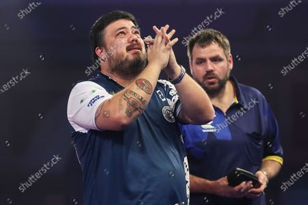Danny Baggish celebrates after his second round win against Adrian Lewis during the William Hill World Darts Championship at Alexandra Palace, London
