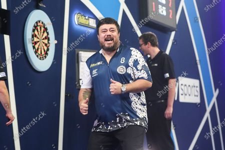 Stock Image of Danny Baggish celebrates fter beating Adrian Lewis in the second round during the William Hill World Darts Championship at Alexandra Palace, London