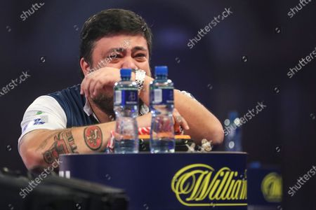 Danny Baggish in Tears after beating Adrian Lewis in the second round during the William Hill World Darts Championship at Alexandra Palace, London