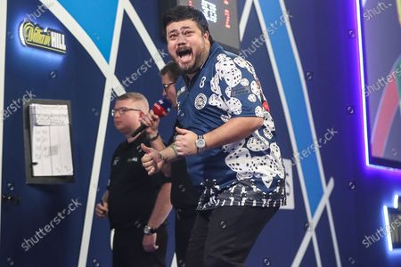 Danny Baggish celebrates after beating Adrian Lewis in the second round during the William Hill World Darts Championship at Alexandra Palace, London