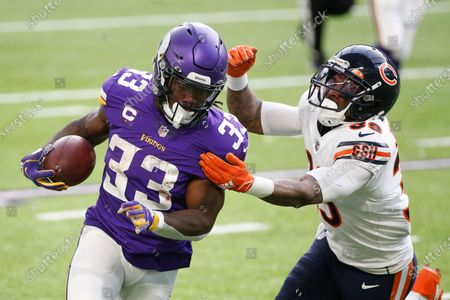Minnesota Vikings running back Dalvin Cook (33) runs from Chicago Bears safety Eddie Jackson (39) during the first half of an NFL football game, in Minneapolis