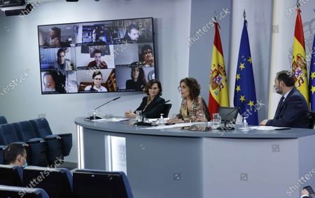 Spanish first deputy Prime Minister Carmen Calvo (L), Spanish Transport Minister Jose Luis Abalos (R) and Spanish Treasury Minister and Government's Spokeswoman, Maria Jesus Montero (C), during a press conference after the cabinet meeting at Moncloa Palace in Madrid, Spain, 22 December 2020.