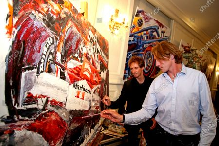 Son of James Hunt, Freddie Hunt, adds some finishing touches to a painting