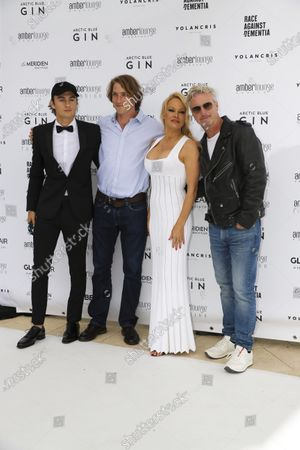 Stock Picture of Pamela Anderson, Eddie Irvine and others at the Amber Lounge Fashion Parade