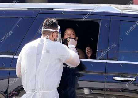 Tracee Ellis Ross gets a coronavirus test as she arrives for the 72nd Primetime Emmy Awards at Staples Center, in Los Angeles