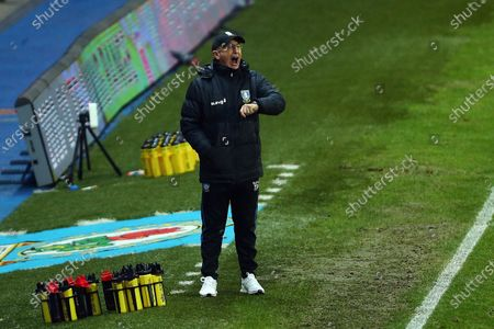 Stock Picture of Sheffield Wednesday's manager, Tony Pulis gestures while looking at his watch