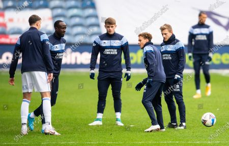Stephen Duke-McKenna of QPR warms up with his with team-mates
