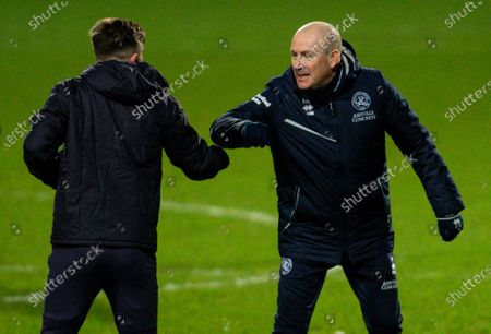 Mark Warburton manager of QPR and Ryan Manning of Swansea City at full time