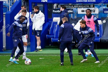 Albert Adomah of QPR warms up alongside Stephen Duke-McKenna of QPR and Bright Osayi-Samuel of QPR