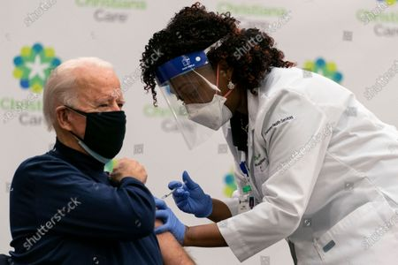 President-elect Joe Biden receives his first dose of the coronavirus vaccine from Nurse partitioner Tabe Mase at Christiana Hospital on live television in Newark Del