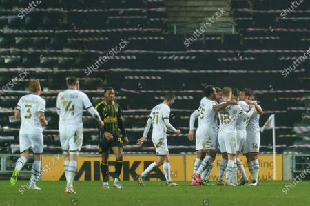 Ben Gladwin of MK Dons (7) celebrates their goal with team-mates, 1-0