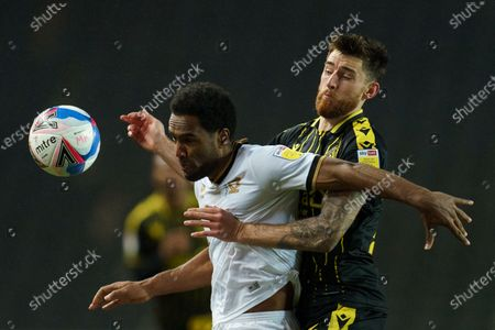 Cameron Jerome of MK Dons (35) and Jack Baldwin of Bristol Rovers (26)
