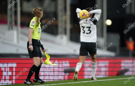 Lineswoman Sian Massey-Ellis watches Antonee Robinson of Fulham take a throw in