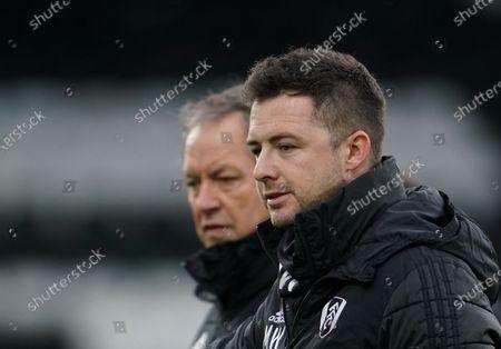Fulham Assistant Manager Matt Wells next to Stuart Gray