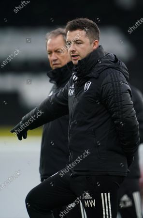 With Scott Parker's absence due to Covid19 quarantining, Fulham assistant coach Matt Wells takes charge, next to Stuart Gray
