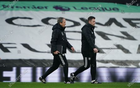With Scott Parker's absence due to Covid19 quarantining, Fulham assistant coach Stuart Gray (l) helpw replacement coach Matt Wells  who takes charge of the team
