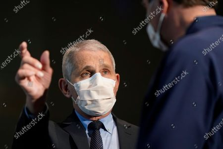 Dr. Anthony Fauci, left, director of the National Institute of Allergy and Infectious Diseases, speaks with Health and Human Services Secretary Alex Azar before receiving his first dose of the COVID-19 vaccine at the National Institutes of Health, in Bethesda, Maryland, USA, 22 December 2020.