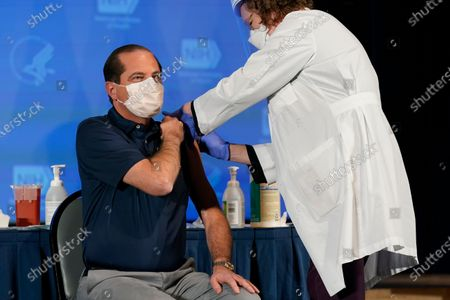 Health and Human Services Secretary Alex Azar receives his first dose of the COVID-19 vaccine at the National Institutes of Health, in Bethesda, Maryland, USA, 22 December 2020.