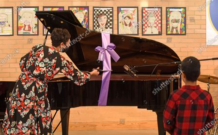 School pupils were stunned when singer Jamie Cullum turned up and gave them his treasured grand piano. The jazz musician delivered his own piano to children at Frith Manor Primary School in Woodside Park, North London, after he was bowled over by a song they wrote called 'We love the piano'.  The priceless Yamaha S6 Grand Piano will now take pride of place in the school's main hall and will be used for concerts, assemblies, and piano lessons. Children at the school had entered their song in a competition run by Yamaha and judged by Cullum, who selected it as the winner for 'showcasing outstanding originality, captivating lyrics, and a cheerful melody'.