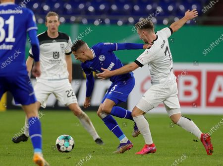 Schalke's Amine Harit (L) in action against Albano Gashi of Ulm during the German DFB Cup second round soccer match between SSV Ulm and FC Schalke 04 in Gelsenkirchen, Germany, 22 December 2020.