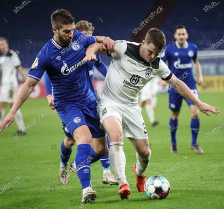Schalke's Matija Nastasic (L) in action against Ulm's Tobias Ruehle during the German DFB Cup second round soccer match between SSV Ulm and FC Schalke 04 in Gelsenkirchen, Germany, 22 December 2020.