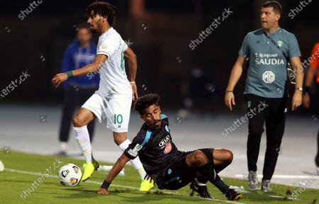 Al-Ahli's player Salman Al-Muwashar (L) in action against Al-Fateh's Nawaf Boushal (R) during the Saudi Professional League soccer match between Al-Ahli and Al-Fateh at King Abdullah Sport City Stadium, 30 kilometers north of Jeddah, Saudi Arabia, 22 December 2020.