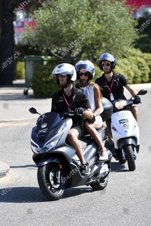 Romain Grosjean, Haas F1, on a scooter with his wife Marion Jolles