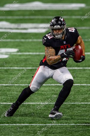 Atlanta Falcons fullback Keith Smith (40) runs the ball during the first half of an NFL football game against the Tampa Bay Buccaneers, in Atlanta. The Tampa Bay Buccaneers won 31-27