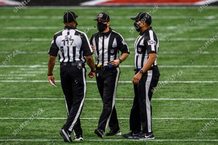 Field judge John Jenkins (117), line judge Walt Coleman (65), and down judge Patrick Holt (106) work during the second half of an NFL football game between the Atlanta Falcons and the Tampa Bay Buccaneers, in Atlanta. The Tampa Bay Buccaneers won 31-27