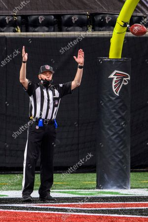 Back judge Greg Meyer (78) signals after a PAT during the second half of an NFL football game between the Atlanta Falcons and the Tampa Bay Buccaneers, in Atlanta. The Tampa Bay Buccaneers won 31-27