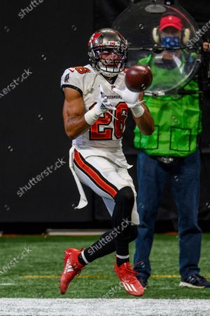 Tampa Bay Buccaneers defensive back Andrew Adams (26) warms up before an NFL football game against the Atlanta Falcons, in Atlanta. The Tampa Bay Buccaneers won 31-27