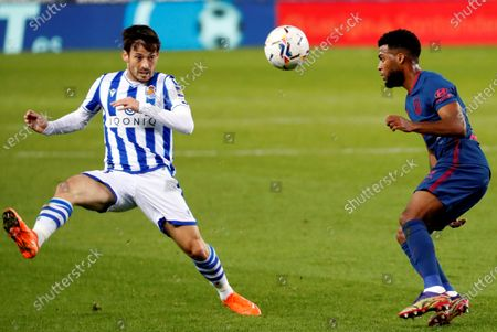 Real Sociedad's David Silva (L) in action against Atletico Madrid's Thomas Lemar (R) during a Spanish LaLiga soccer match between Real Sociedad and Atletico Madrid at Reale Arena stadium in San Sebastian, Basque Country, northern Spain, 22 December 2020.
