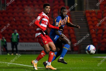 Shrewsbury Town defender Aaron Pierre (2) and Doncaster Rovers forward Tyreece John-Jules (19) in action during the EFL Sky Bet League 1 match between Doncaster Rovers and Shrewsbury Town at the Keepmoat Stadium, Doncaster