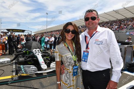 Stock Photo of Tamara and Eric Boullier on the grid