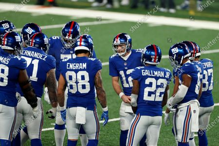 New York Giants quarterback Colt McCoy (12) in a team huddle during an NFL football game against the Cleveland Browns, in East Rutherford, N.J