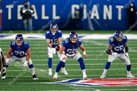 New York Giants center Nick Gates (65), offensive guard Kevin Zeitler (70) and offensive guard Shane Lemieux (66) in front of quarterback Colt McCoy (12) during an NFL football game, in East Rutherford, N.J