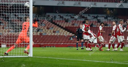 Players watch as a ball from Manchester City's Riyad Mahrez, not pictured, beats Arsenal's goalkeeper Runar Alex Runarsson, left, to score their second goal during the English League Cup quarterfinal soccer match between Arsenal and Manchester City at Emirates Stadium, London