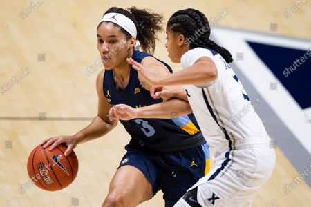 Stock Picture of Marquette Golden Eagles guard Rose Nkumu (3) drives past Xavier Musketeers guard Aaliyah Dunham (3) during an NCAA basketball game on in Cincinnati, Ohio
