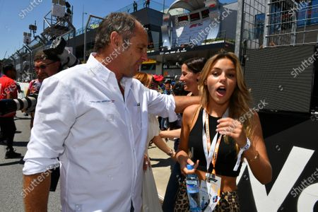 Gerhard Berger and a guest
