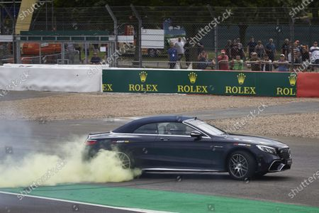 Stock Image of Lewis Hamilton, Mercedes AMG F1, drives Sir Frank Williams in an AMG S 63