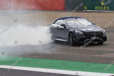 Lewis Hamilton, Mercedes AMG F1, drives Sir Frank Williams in an AMG S 63