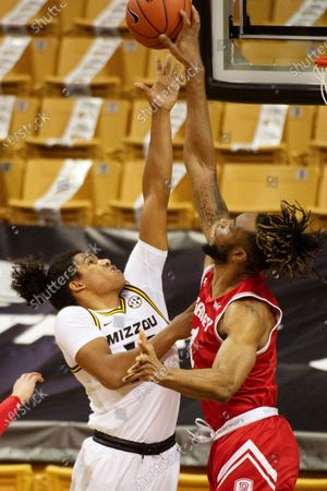 Missouri's Dru Smith, left, has his shot blocked by Bradley's Ari Boya, right, during the first half of an NCAA college basketball game, in Columbia, Mo